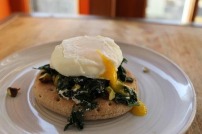 Breakfast Sandwich with Goat Cheese, Pistachios, Kale and Poached Egg