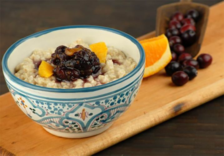 Slow cooked creamy oatmeal with cranberry orange compote