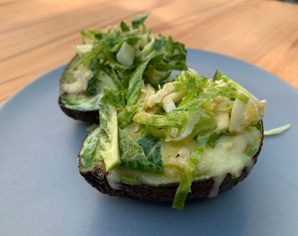 Avocado baked eggs with Brussel sprout salad