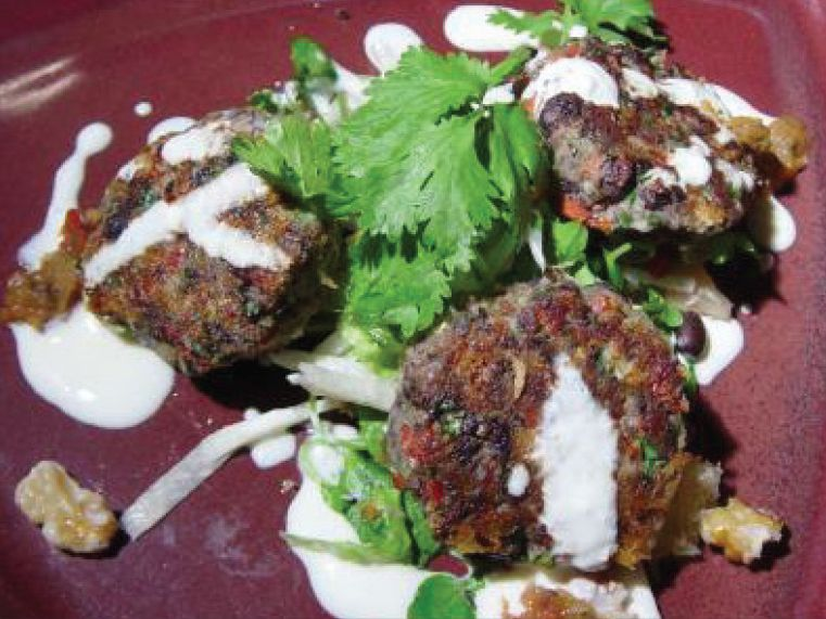 Shrimp with black bean cakes with lime crema
